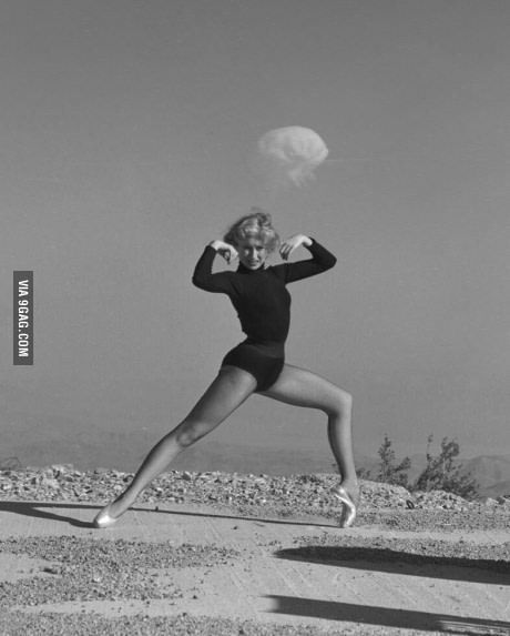Dancer with a nuclear explosion in the background, Nevada, 1950.